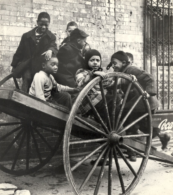 , 'Group of Children Playing on Wooden Cart with Huge Wheels, New York City,' ca. 1950, Charles Schwartz Ltd.