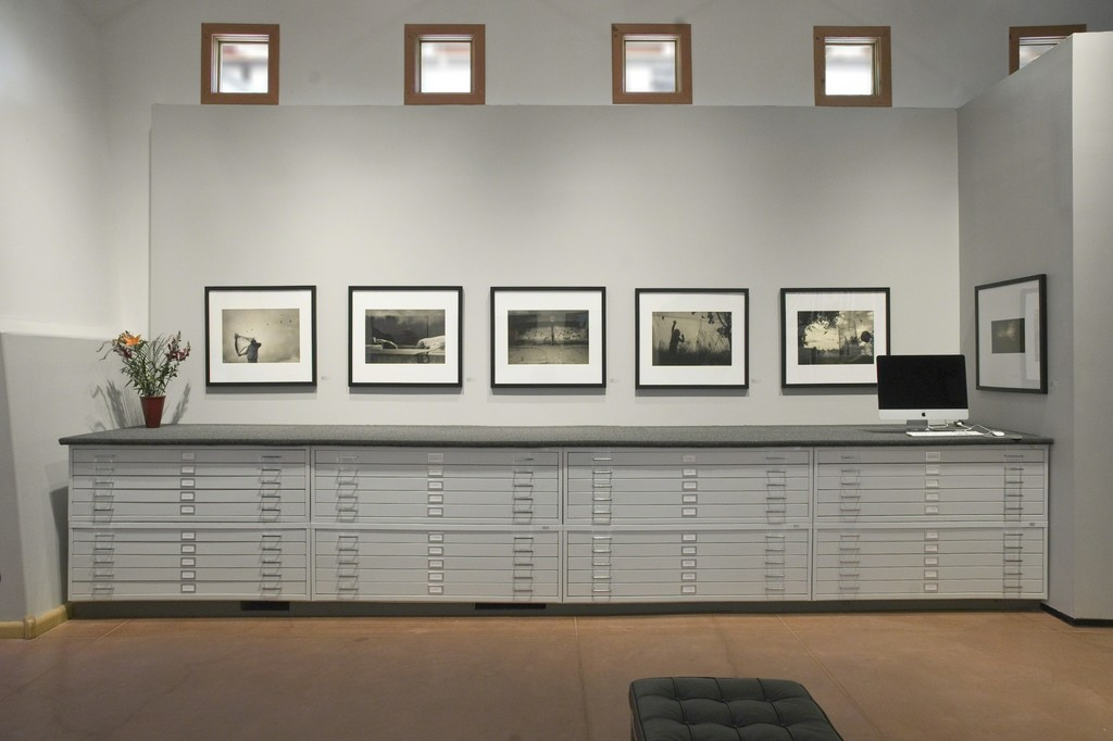 Images from Angela Bacon-Kidwell's Traveling Dream series installed about the flat files in photo-eye Gallery's main room.
