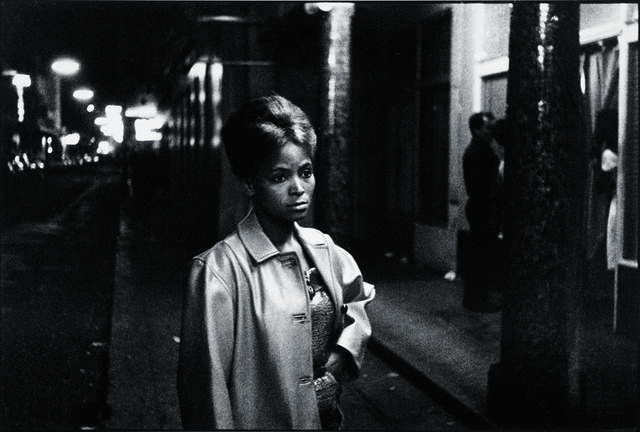 , 'Sad-eyed model in this street of merry-making,' 1962, Aperture Foundation