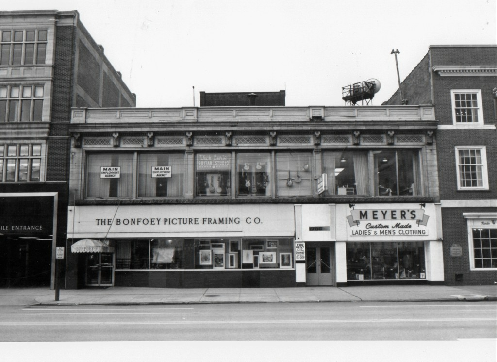 "Our original outdoor signage and store facade. Neither of the two buildings on either side of us are still there. To the right is now 17th street AKA ""Viktor Schreckengost Way"" and to the left is a new 10 story apartment building. Makes me feel like the house in the movie ""Up"""