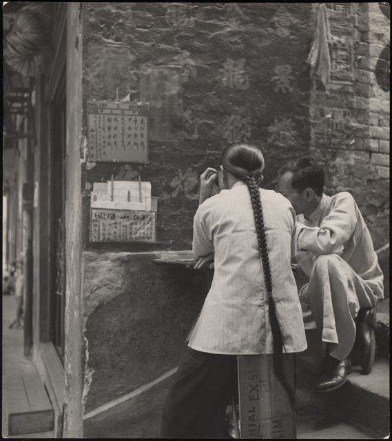 , 'The public letter writer at his stand on the streets in Hong Kong,' 1952, Magnum Photos