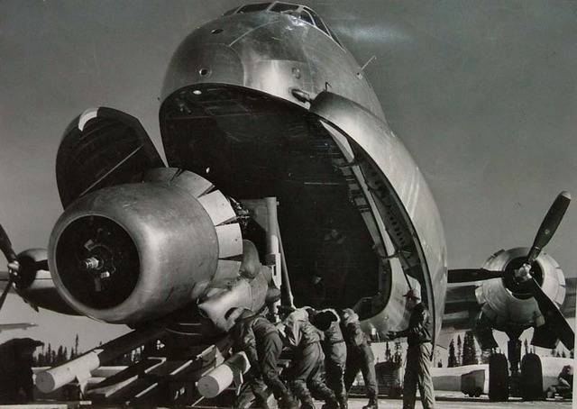 Margaret Bourke-White, 'Crewmen Unloading Huge B-50 Bomber Plane Engine Used as a Spare from the Belly of a C-124 Cargo Plane upon Arrival at Strategic Air Command's Base, Greenland, TX', 1951, Contessa Gallery