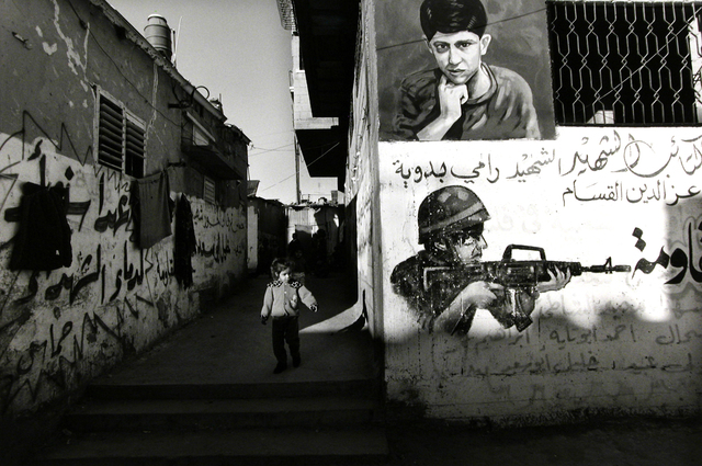 , 'Shati Refugee Camp, Gaza Strip [refugee child and graffiti],' 2001, Stephen Bulger Gallery