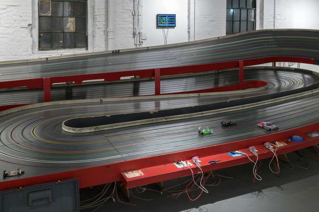 A detail of the driving area of the slot car track.