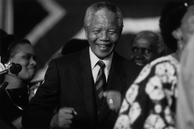, 'A jubilant Nelson Mandela after the announcement proclaiming ANC victory in South Africa. ,' 1994, Magnum Photos