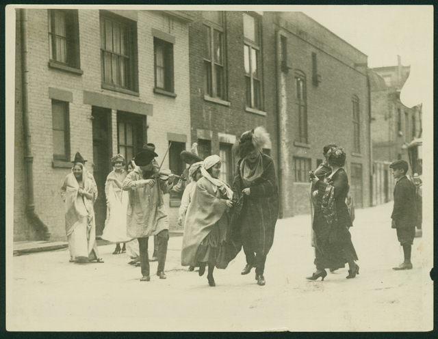 , 'Photographic portrait of twelve people in costume at a party in MacDougal Alley, New York,' ca. 1924, Delaware Art Museum