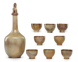 Early decanter with animal stopper and eight small cups