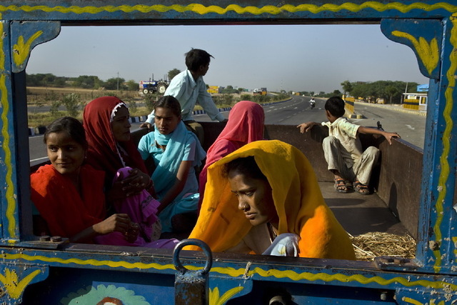 , 'Day laborers hitch a ride along the Golden Quadrilateral Highway in Rajasthan, India,' 2007, Anastasia Photo