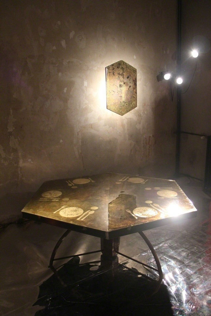 "The wall-panel and the ""Apparecchiato per sei"" table maintain the imperfect hexagonal forms intone with the artists wish to not conform to the banal"