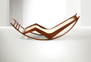 a chaise longue rocking chair