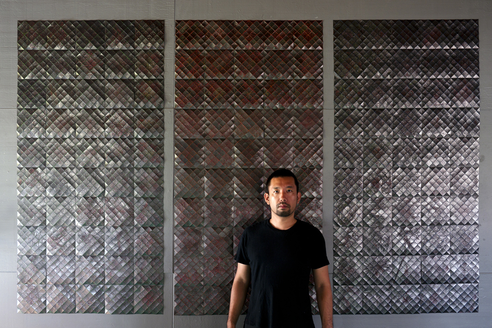 The artist Takayuki Daikoku in front of his major three-partite work 'RGB', 2017, 180 × 283 cm, acrylic, graphite on paper; photo: Takayuki Daikoku