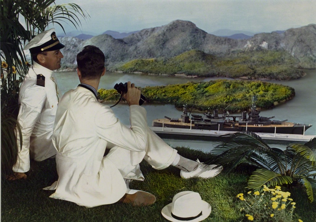 Lejaren à Hiller, 'Naval officer and young man on hillside with binoculars, overlooking battleship in bay below,' 1950, George Eastman House International Museum of Photography & Film
