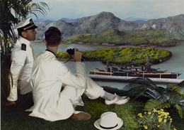 , 'Naval officer and young man on hillside with binoculars, overlooking battleship in bay below,' 1950, George Eastman Museum