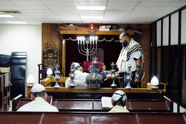 , 'The Rabbi of the Sefarati Synagogue presides over a service,' 2015, Anastasia Photo
