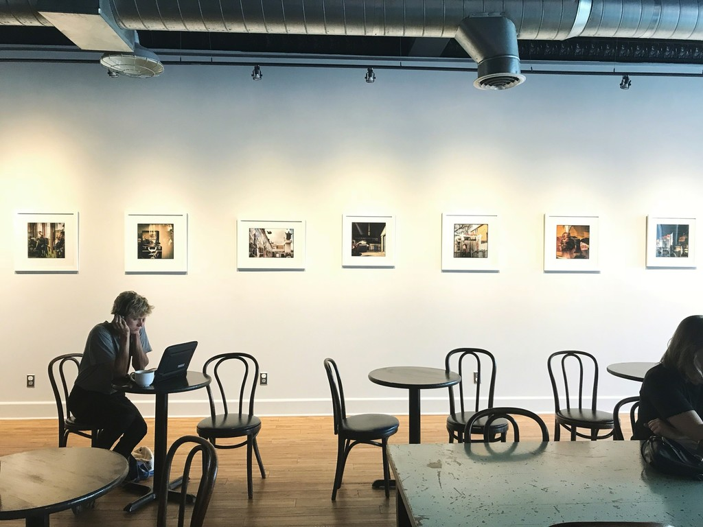 Colorful Pictures of Hamtramck installed at Oloman Cafe in Hamtramck.