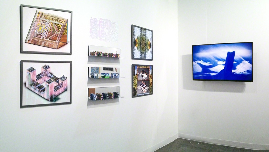 Brenna Murphy prints and sculptures next to a video work by Ryan Whittier Hale during the Seattle Art Fair.