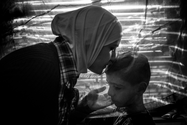 , 'Amira Raslan conforts her son Aur, Berlin, 2016. The family fled Syria for safty in Germany in 2015,' , Monroe Gallery of Photography