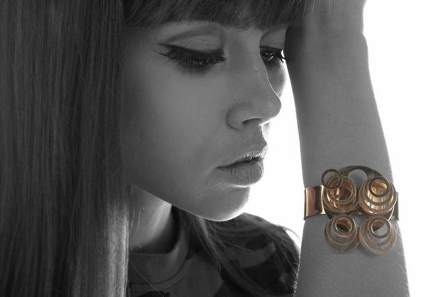 """, '""""Douze anneaux sur quatre tiges' gold bangle with kinetic rings,' 1971, Didier Ltd."""