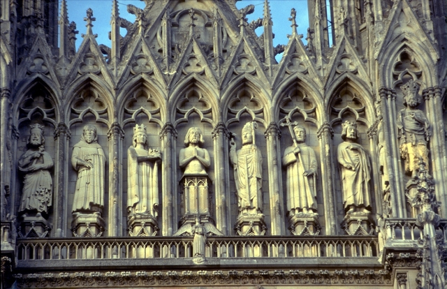 'Reims Cathedral: exterior, detail of West facade showing upper levels, niche statues of the French monarchy and Saints of France', ca. 1211-1290, Allan Kohl