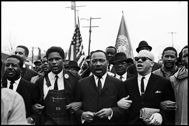 , 'Dr. King leads the Freedom March along with Ralph Abernathy, James Forman and Reverend Jessie Douglas around the State Capitol in Montgomery in protest of unfair treatment of African Americans and voter discrimination.,' 1965, Monroe Gallery of Photography