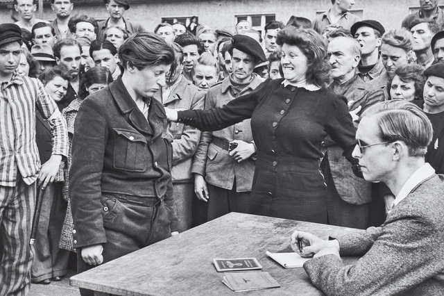Henri Cartier-Bresson, 'Gestapo informer recognised by a woman she had denounced, Transit Camp, Dessau, Germany', 1945, Phillips