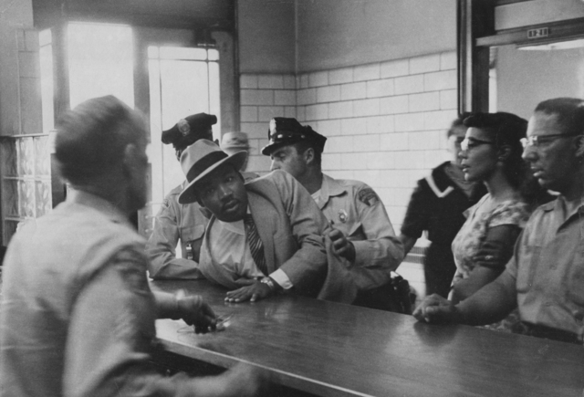 , 'Martin Luther King Jr.is Arrested for Loitering Outside a Courtroom Where his Friend Ralph Albernathy is Appearing for a Trial. As His Wife Looks on, King is Sprawled Across the Police Desk,' 1958, Steven Kasher Gallery