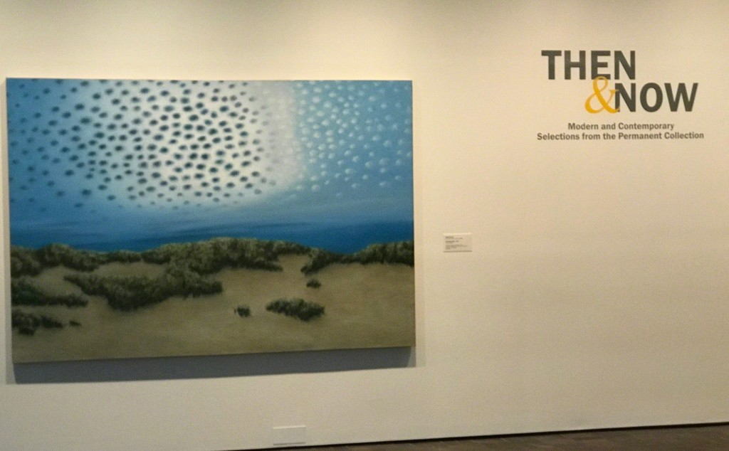 At the entrance to Then & Now, April Gornick, April 20, 1953, Cleveland, OH, Changing Sky, 1980, oil on canvas, 65 5/8 x 96 1/4 inches, unsigned, Collection Neuberger Museum of Art, Purchase College, State University of New York, Gift of Roy R. Neuberger