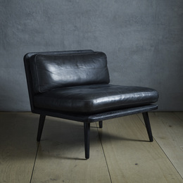 Spine lounge chairs, pair