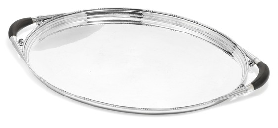 Large oval sterling silver serving tray with hammered surface.