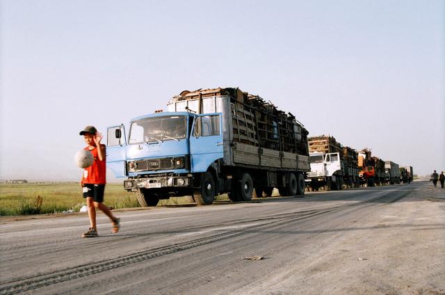 Gulnara Kasmalieva & Muratbek Djumaliev, 'Boy and Truck Caravan', 2006, Winkleman Gallery