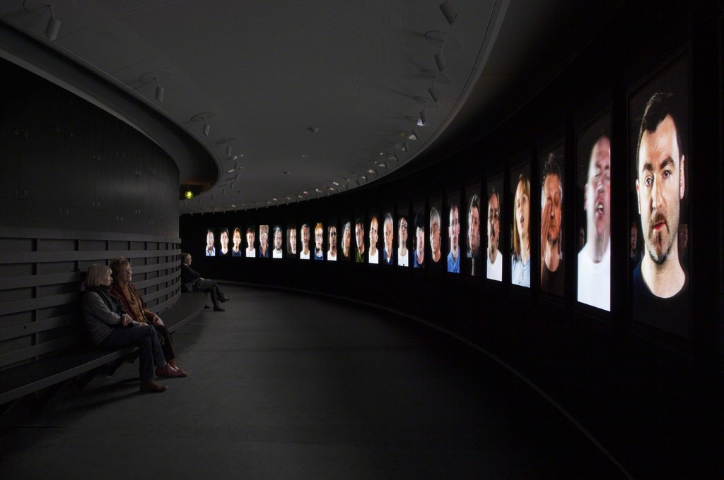 Installation shot of Candice Breitz' Working Class Hero (A Portrait of John Lennon), 2006. 25-channel video installation. From the exhibition Fire under Snow: New film and video works at Louisiana (27.1.-8.5.2016), Louisiana Museum of Modern Art.