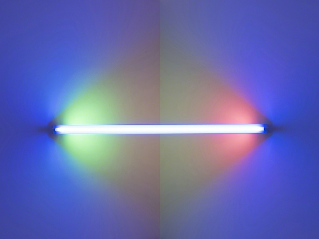 Dan Flavin,untitled (to Janie Lee) two, 1971. Blue, pink, yellow, and green fluorescent light. 8 ft. wide across a corner. Installation view:Dan Flavin: cornered fluorescent light, Mana Contemporary, Jersey City, 2018. Photo: John Berens. Courtesy of the Estate of Dan Flavin