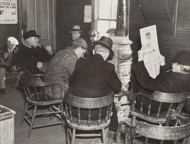 Russell Lee, 'Farmers Sitting Around the Stove Enjoying Themselves and Getting Warm, Weighing-in Room of the Stockyards, Aledo, Illinois', 1936, Photography, Gelatin silver, printed later, Heritage Auctions
