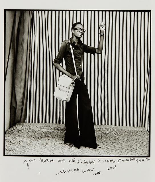 Malick Sidibé, 'Jeune Homme, pattes d'elephant, avec sacoche et montre, 1977', 2014, Phillips