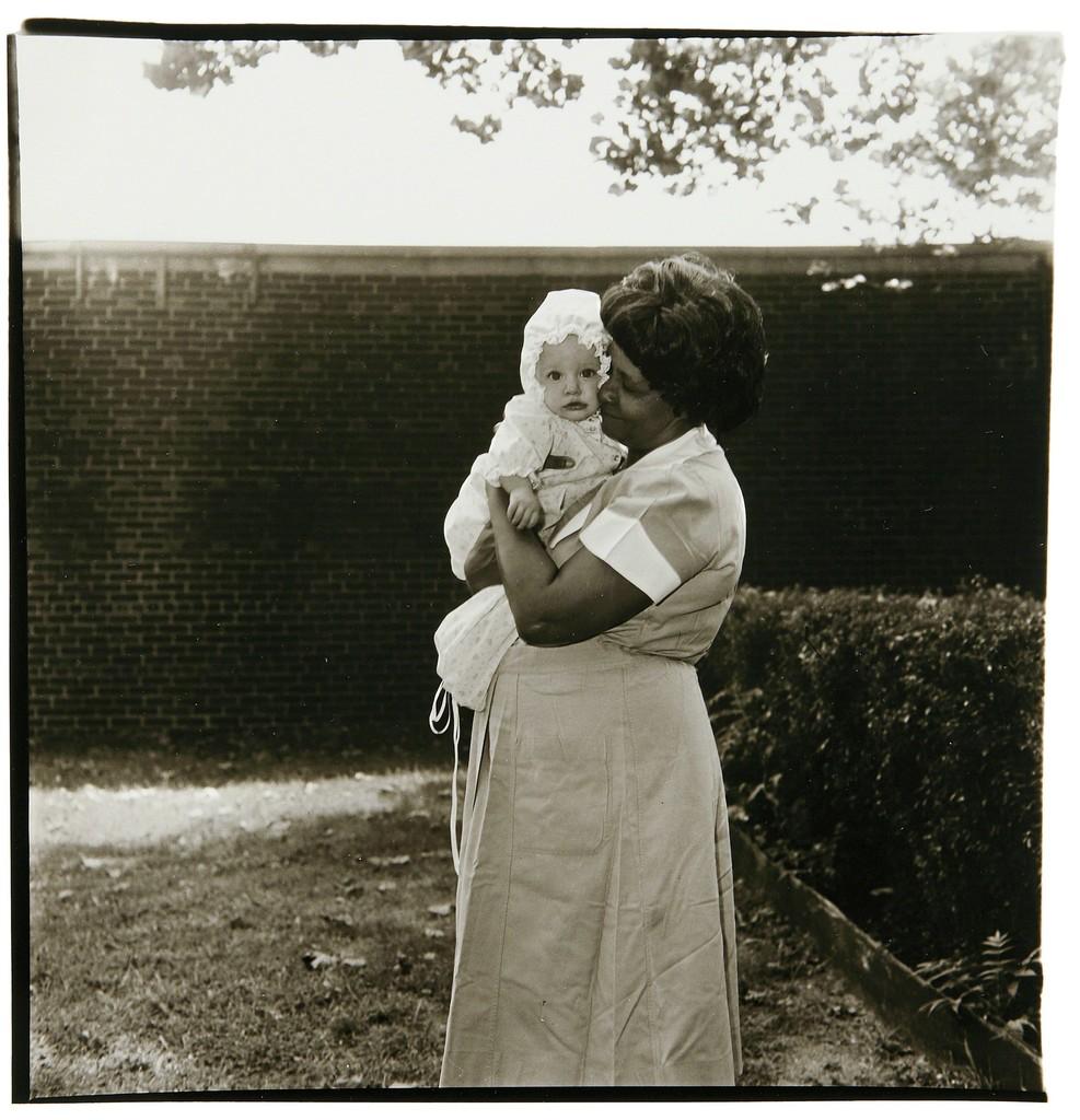 Toddler being held in garden, N.J.