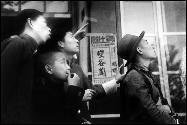 , 'Watching as Chinese fighter planes. Hubei, Hankou. China. ,' 1938, Magnum Photos