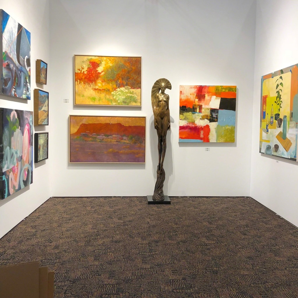 """Sun Goddess"", Kraig Varner, watches over the desert hues of Andy Taylors ""Pico"" and ""Posterior"" and Brent Godfrey's ""Untitled Desert"""