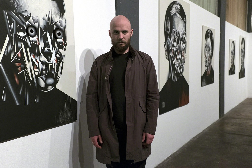 Artist Bohdan Burenko with his HEADS exhibition at Anno Domini.