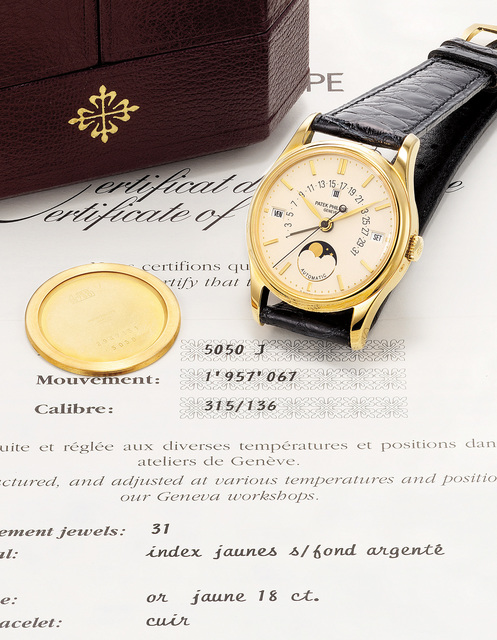 Patek Philippe, 'A rare, very elegant and exceptionally fine yellow gold perpetual calendar wristwatch with center seconds, moonphases, retrograde date, certificate and box', 1993, Phillips