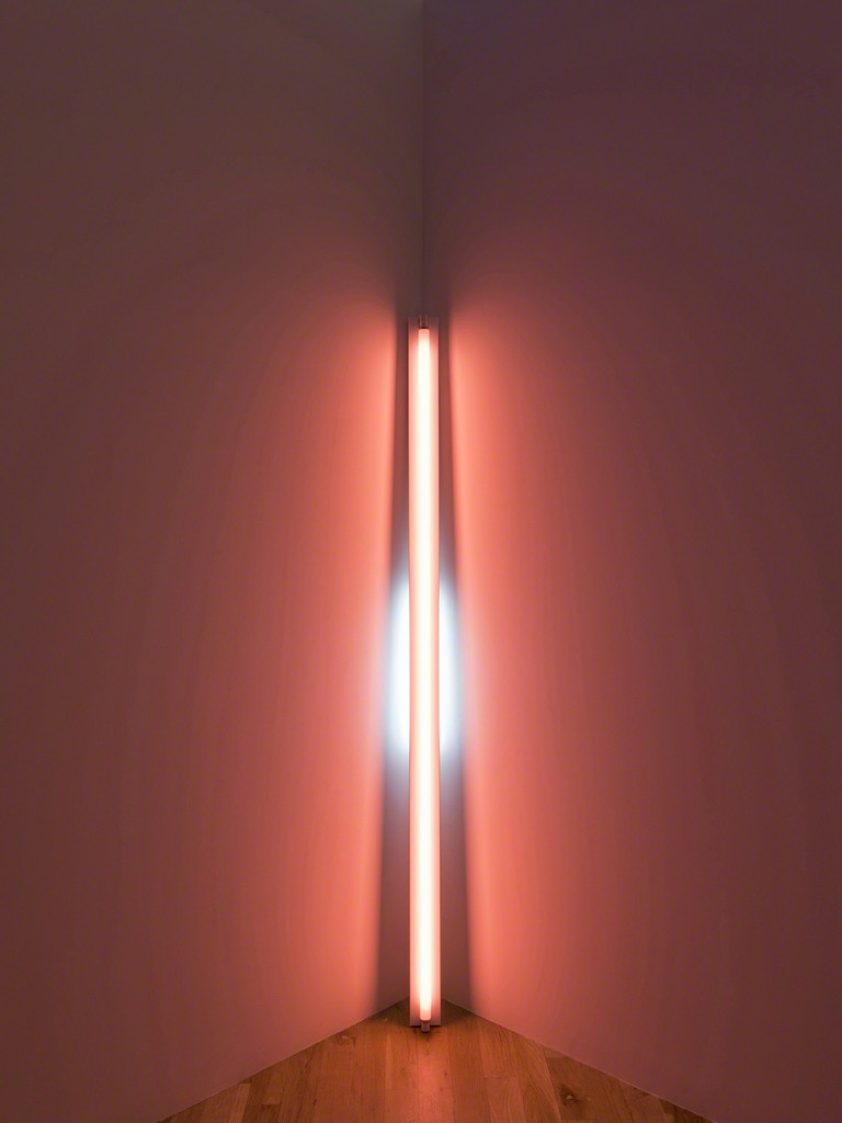 Dan Flavin, untitled (to Shirley and Jason), 1969. Pink and blue fluorescent light. 8 ft. leaning into a corner with the top of the 20W tube touching the corner. Installation view:Dan Flavin: cornered fluorescent light, Mana Contemporary, Jersey City, 2018. Photo: John Berens. Courtesy of the Estate of Dan Flavin