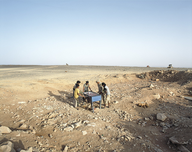 , 'Ubari, Southern Libya, 2015. Tuareg tribe militiamen playing babyfoot on Tende Mount. ,' 2015, East Wing