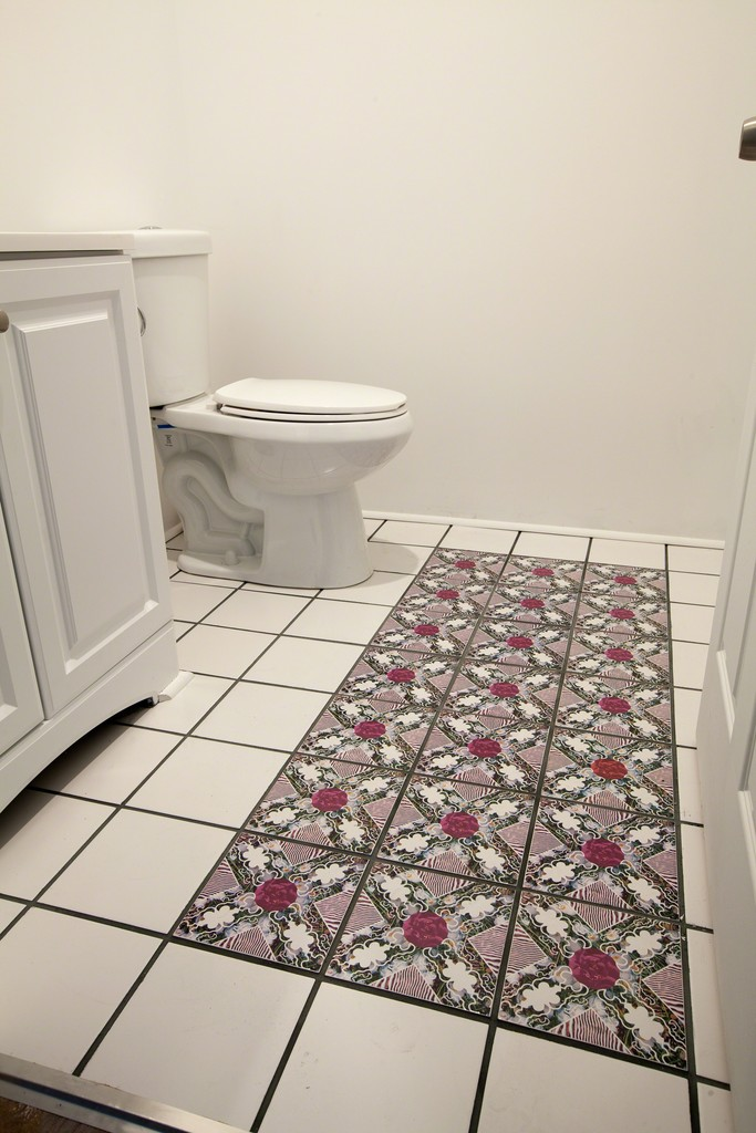 Permanent tile installation in gallery bathroom in conjunction with Flowers of War exhibition.