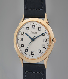 "A unique, historically important, and unusual gold-filled time-only wristwatch with center seconds and ""Lucky 13"" dial"