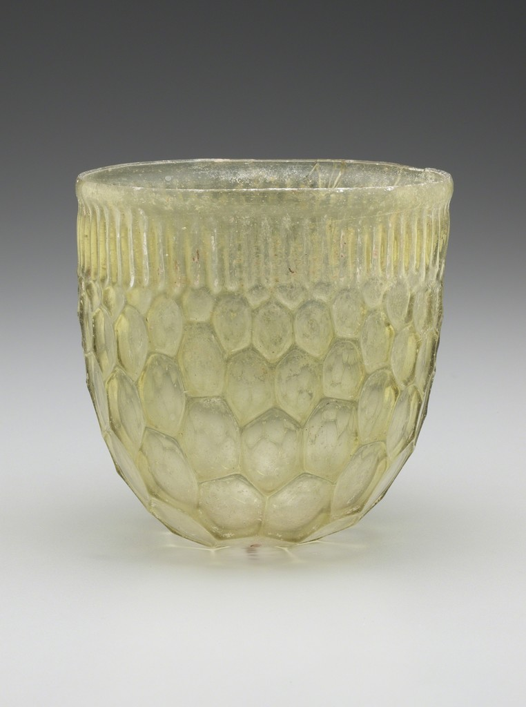 Honeycomb Beaker, Roman, Eastern Mediterranean or Western Empire, 4th century A.D. Cast and free-blown glass, H. 4 5/8 × DIAM. 4 ¾ in. (11.7 × 12.1 cm). Yale University Art Gallery, Hobart and Edward Small Moore Memorial Collection, Bequest of Mrs. William H. Moore, 1955.6.71