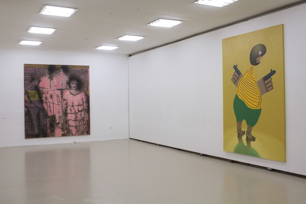 """Fragment of exhibition """"Družba"""". On the left: Jonas Gasiūnas, LITHUANIAN OPERA OR WOMAN, SMOKE AND BLIND MAN (2018, oil and charcoal from candle smoke on canvas, 285 x 240 cm). On the right: Kaido Ole, """"Armed Freak"""" (2014, oil, acrylic and alkyde paint with plastic details on canvas, 280 x 190 cm)"""