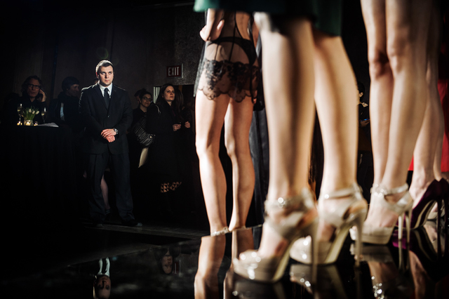 , 'A security guard looks at the models during La Perla's presentation at the Dream Hotel. Mercedes-Benz Fashion Week, New York City, Spring 2014.,' 2014, Anastasia Photo