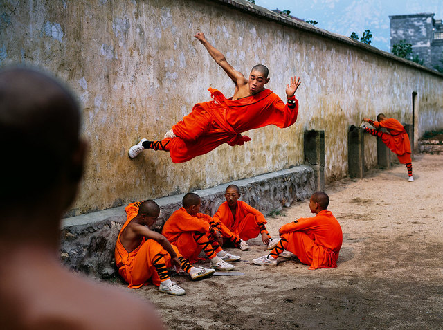 , 'A young monk runs along the wall over his peers at the Shaolin Monastery in Henan Province, China,' 2004, Sundaram Tagore Gallery