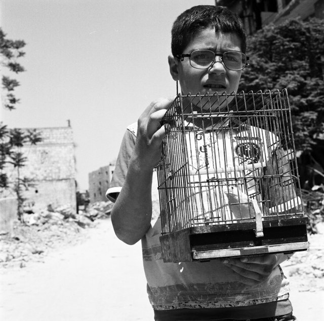 , 'Hussein with his Birdcage at Kastal al-Harami, Eastern Aleppo, May 2017 - Aleppo,' 2017, Flatland Gallery