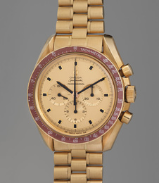 A rare and highly attractive limited edition yellow gold chronograph wristwatch with burgundy bezel and bracelet, made to commemorate the Apollo XI moon landing, limited edition number 120