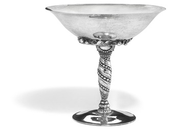 Silver centerpiece with hammered surface and leaves. Spiral fluted stem with beads.